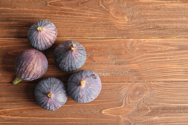 Ripe sweet figs on wooden background, top view stock images