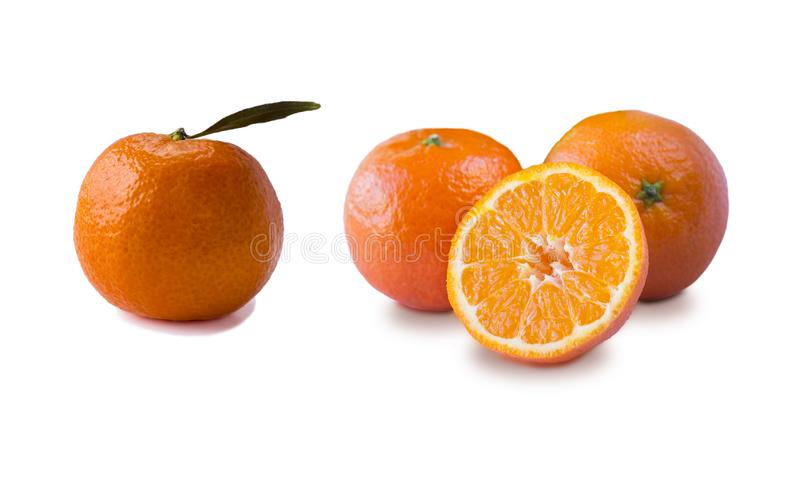 Ripe and tasty tangerines isolated on white background. Fresh clementines with copy space for text. Mandarin slice isolated on whi stock photo