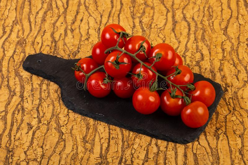 Ripe tomato branch royalty free stock image