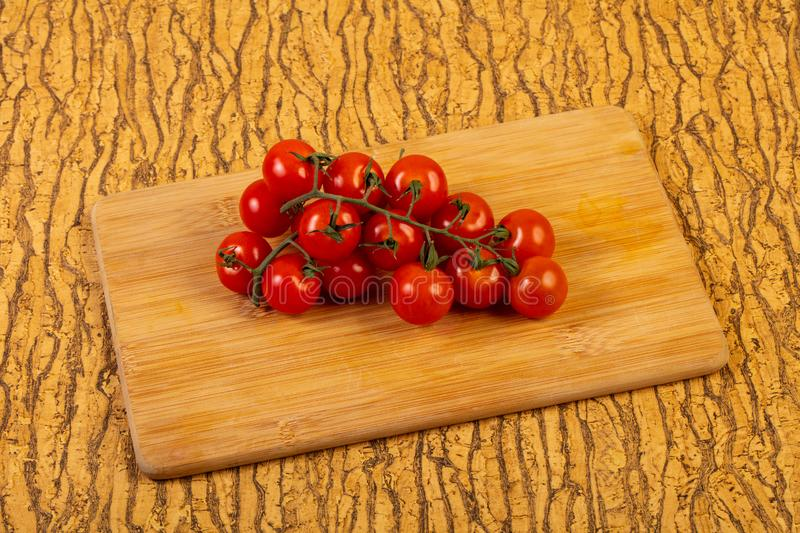 Ripe tomato branch royalty free stock photo
