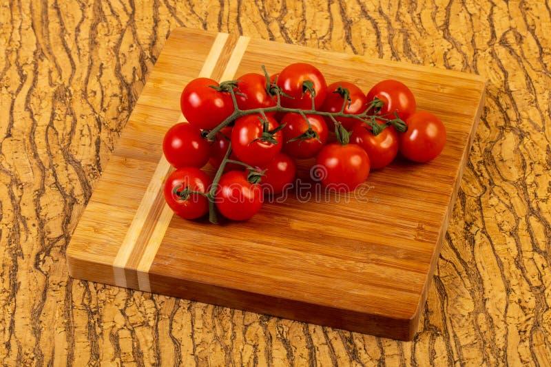 Ripe tomato branch royalty free stock photo