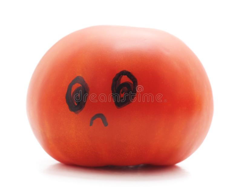 Ripe tomato with a human face. On white background royalty free stock photos