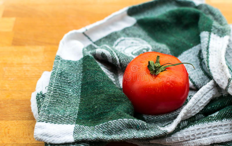 Ripe tomato on wooden board stock photography