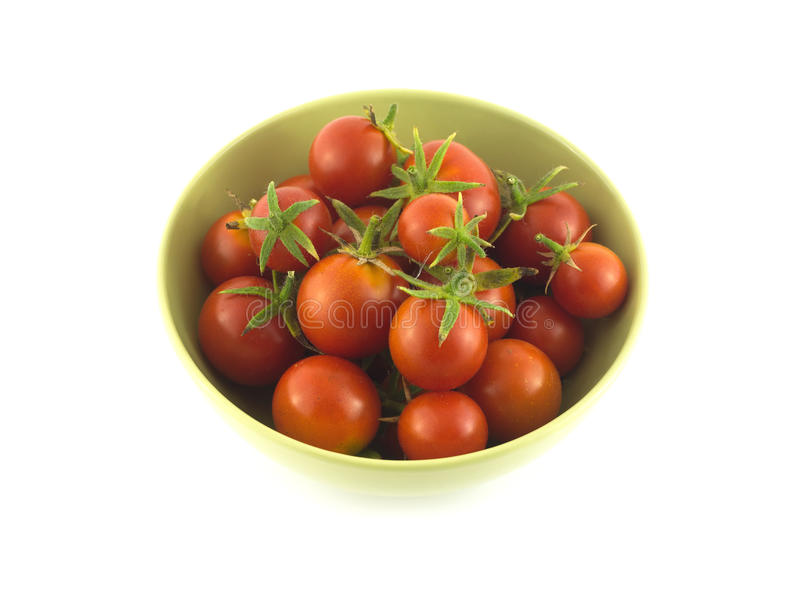 Ripe tomatoes in bowl closeup isolated stock photography
