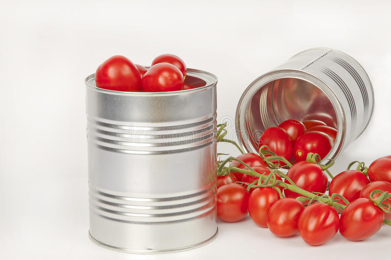 Ripe tomatoes in tin cans stock image
