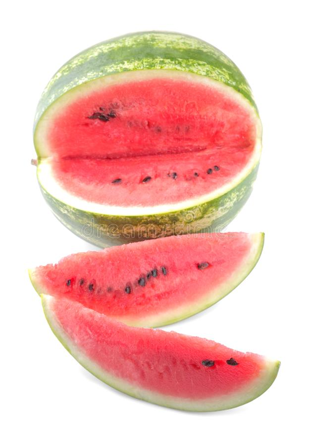 Ripe watermelon and two slices are next to a white background. isolated royalty free stock images