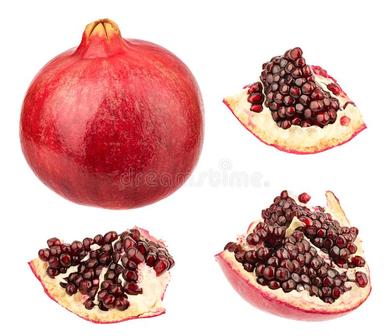 Pomegranate and pieces with seeds. Ripe whole pomegranate and collection of pieces with seeds. Healthy food rich of vitamines stock photo
