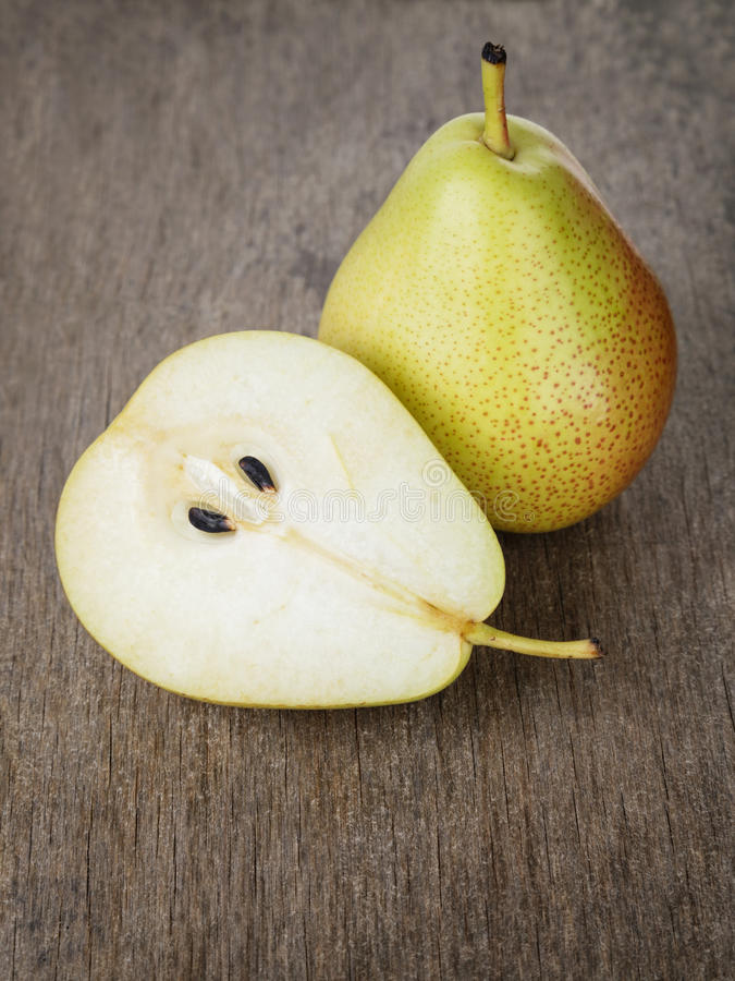 Ripe williams pears. On old wooden table royalty free stock photo