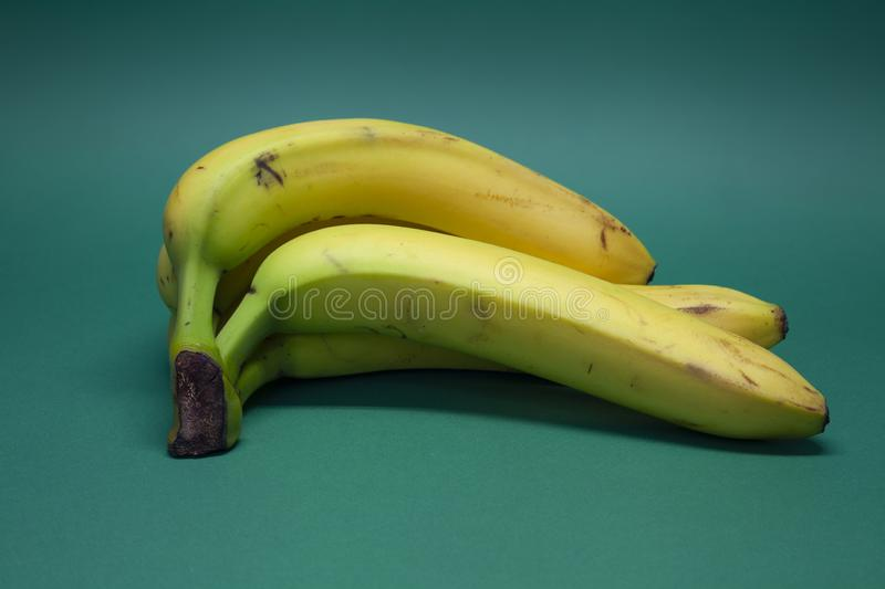 Ripe yellow bananas fruits, bunch of ripe bananas with dark spots royalty free stock images