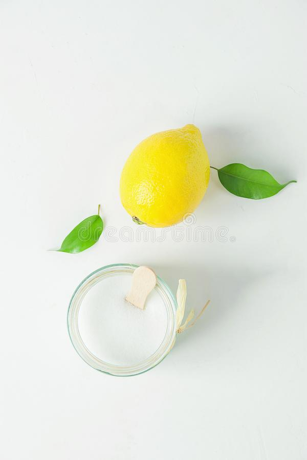 Ripe Yellow Lemon Green Citrus Leaves Sugar in Glass Jar. Ingredients for Face Scrub on White Concrete Stone stock photos