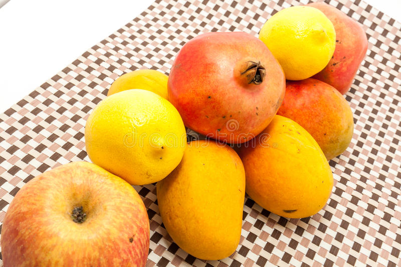Ripe yellow and red colored mango fruits on mat background. Ripe yellow and red colored mango fruits on brown check mat background stock images