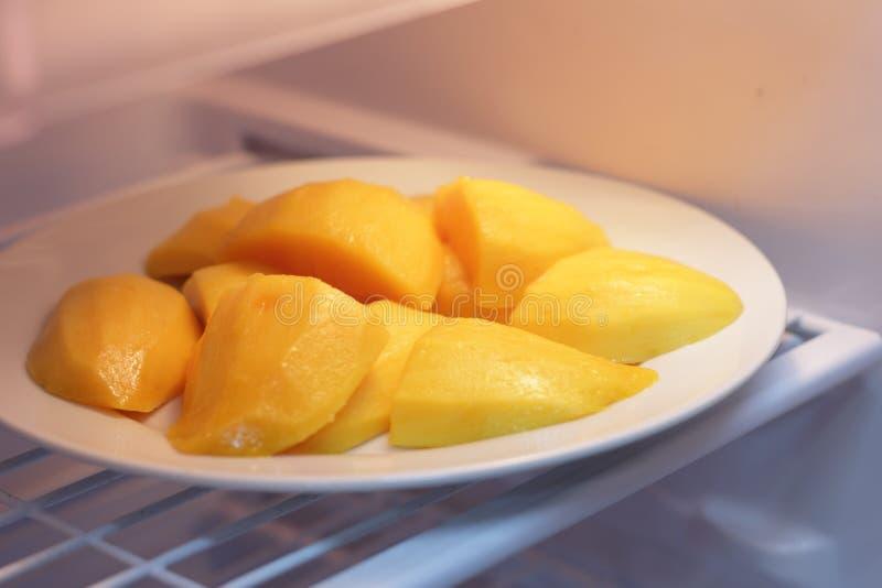 Ripe yellow red mango slice stock photo