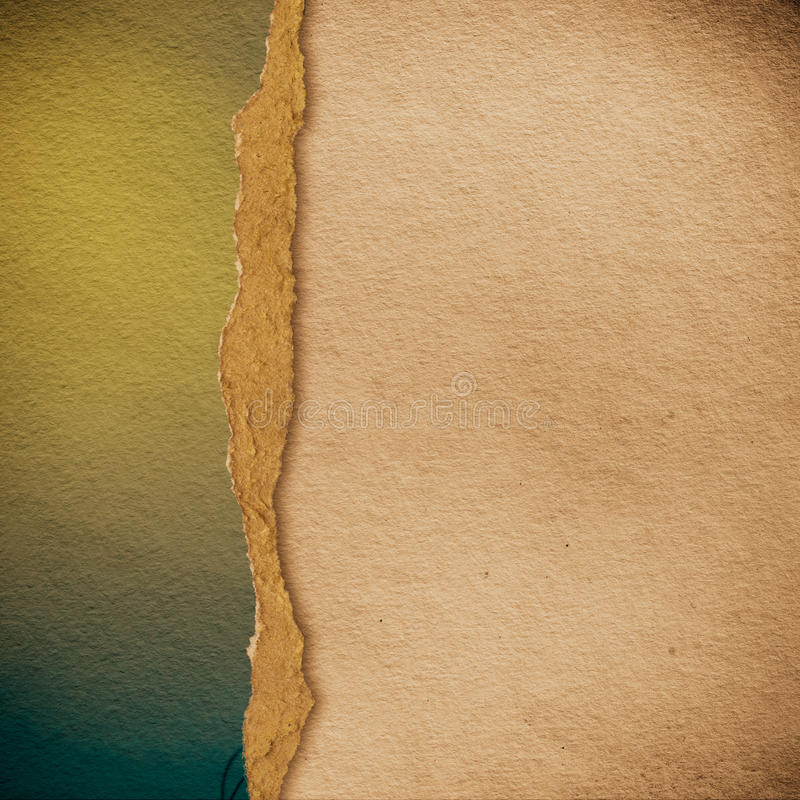 Riped vintage paper on grunge background stock photo
