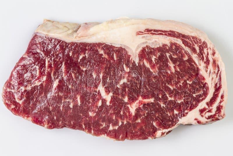 Ripened晒干了牛肉臀部或striploin牛排在被隔绝的白色背景 免版税库存照片