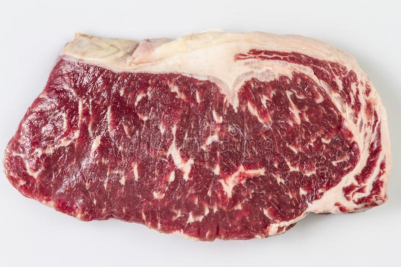 Ripened seasoned beef rump or striploin steak on white background isolated. Yop view royalty free stock photo