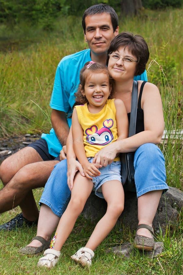 Riposo felice della famiglia fotografia stock libera da diritti