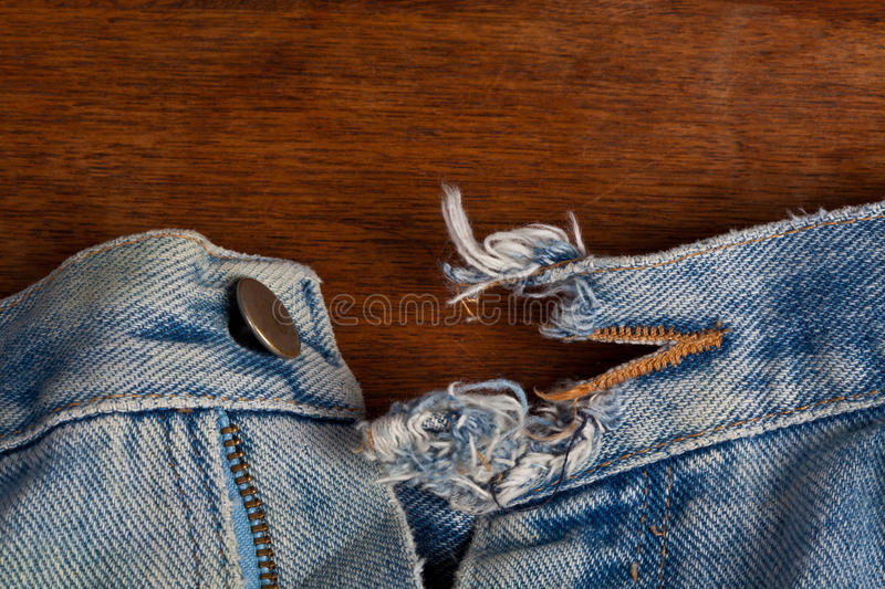 Ripped button hole royalty free stock photography