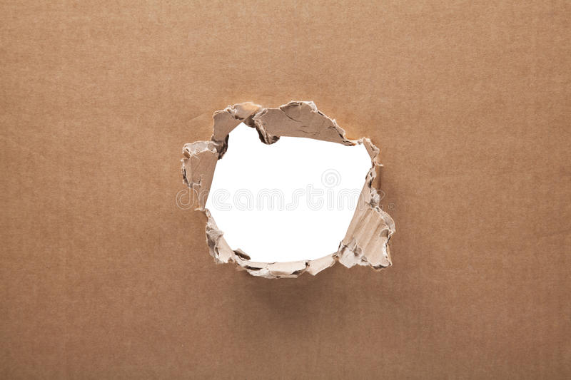 Download Ripped Hole In Cardboard On White Background Stock Photo - Image: 83703998