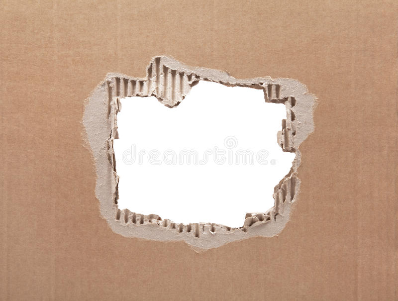 Download Ripped Hole In Cardboard On White Background Stock Photo - Image: 83704094