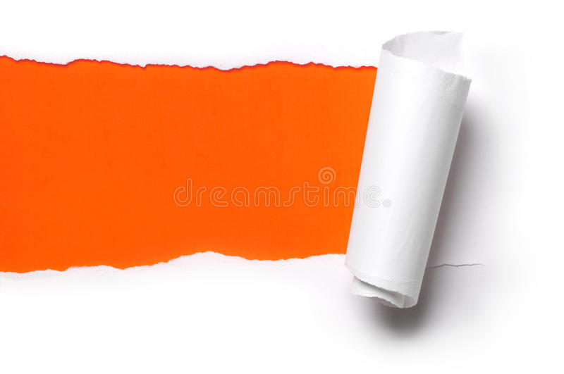 Ripped paper. Ripped white paper against a orange background stock image