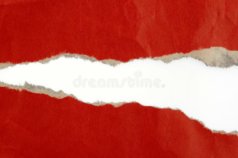Ripped paper. Hole ripped in red paper on plain background royalty free stock photo