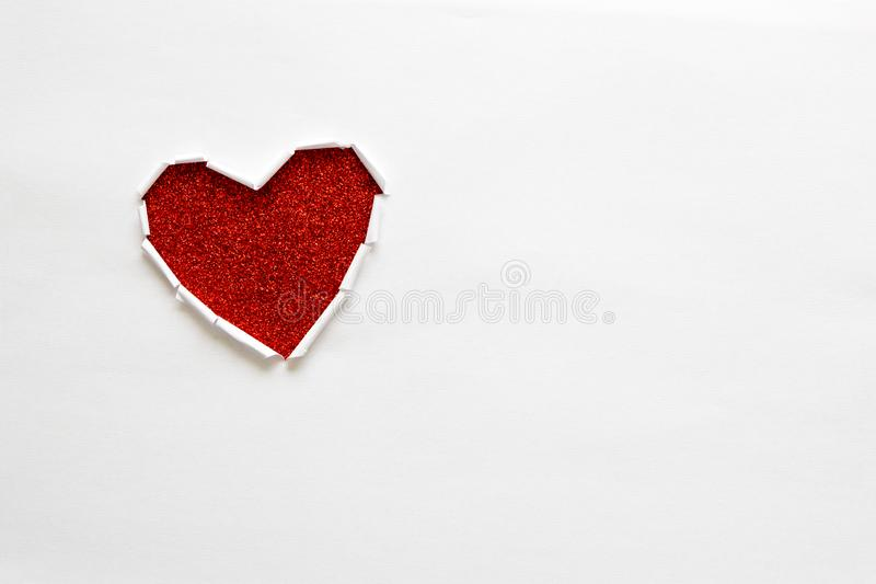 Ripped paper hole heart shaped on white paper background. Valentine`s day celebration concept stock photography