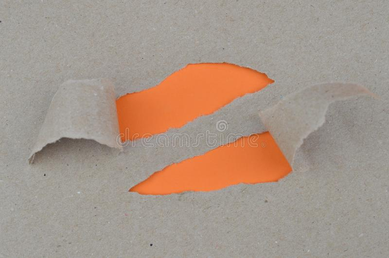 Ripped paper revealing orange blank spaces for text royalty free stock images