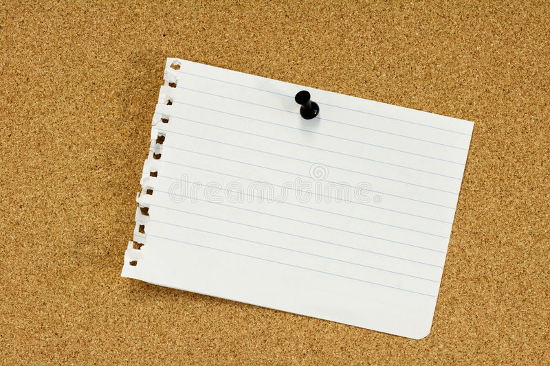 Ripped paper sheet. Pinned on corkboard royalty free stock photos
