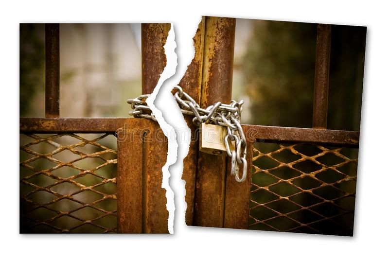 Ripped photo of a rusty metal gate closed with padlock - Freedom concept image stock images