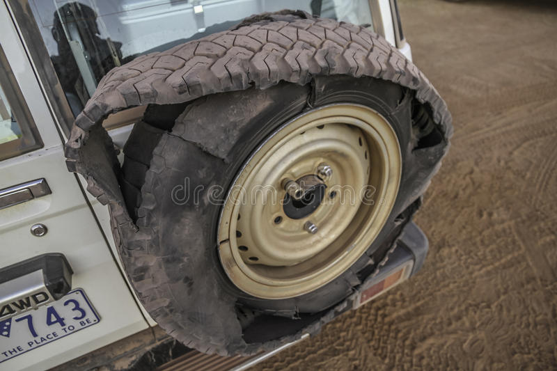 Ripped tyre stock image