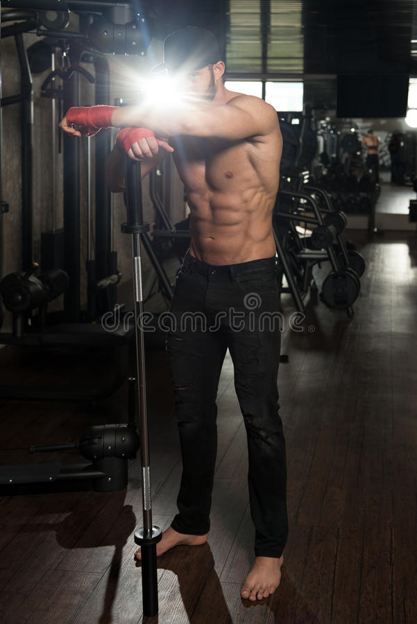 Ripped Young Man In Modern Fitness Center. Portrait Of A Physically Fit Man Showing His Well Trained Body In Gym stock photography