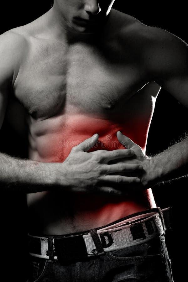 Rippen und Magen in den Schmerz lizenzfreie stockfotos