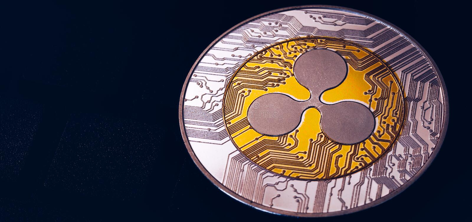Ripple cryptocurrency crypto currency. Silver Ripple coin with gold Ripple symbol. Ripple XRP cryptocurrency.  stock image