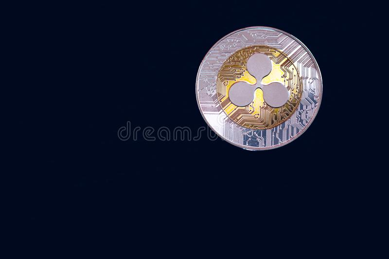 Ripple cryptocurrency crypto currency. Silver Ripple coin with gold Ripple symbol. Ripple XRP cryptocurrency.  royalty free stock photo