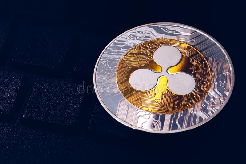 Ripple cryptocurrency crypto currency. Silver Ripple coin with gold Ripple symbol. Ripple XRP cryptocurrency.  royalty free stock image