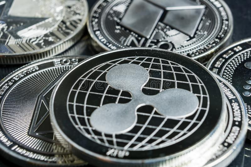 Ripple cryptocurrency physical coin surrounded with variety of other crypto altcoins. stock images