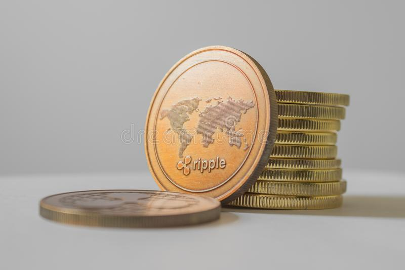 Ripple XRP close-up of the world`s crypto-virtual payment system. Smartphone, reading financial news on stock markets. Ripple XRP and cryptocurrency investing stock photography
