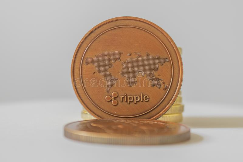 Ripple XRP close-up of the world`s crypto-virtual payment system. Smartphone, reading financial news on stock markets. Ripple XRP and cryptocurrency investing stock photos