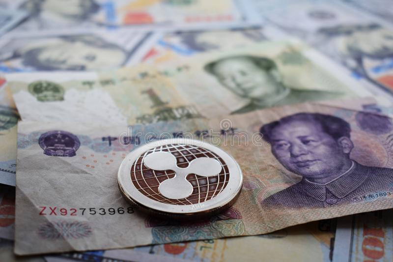 Ripple XRP Coin on Chinese Yuan and US dollar. Close-up stock photos