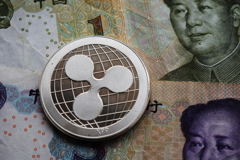 Ripple XRP Coin on Chinese Yuan. And US dollar. Close-up background bank banking banknotes bit business cash china cny coins concept crisis crypto cryptography stock photos