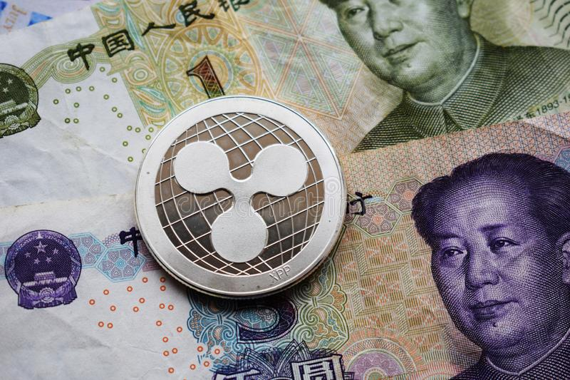 Ripple XRP Coin on Chinese Yuan. Close-up stock photo