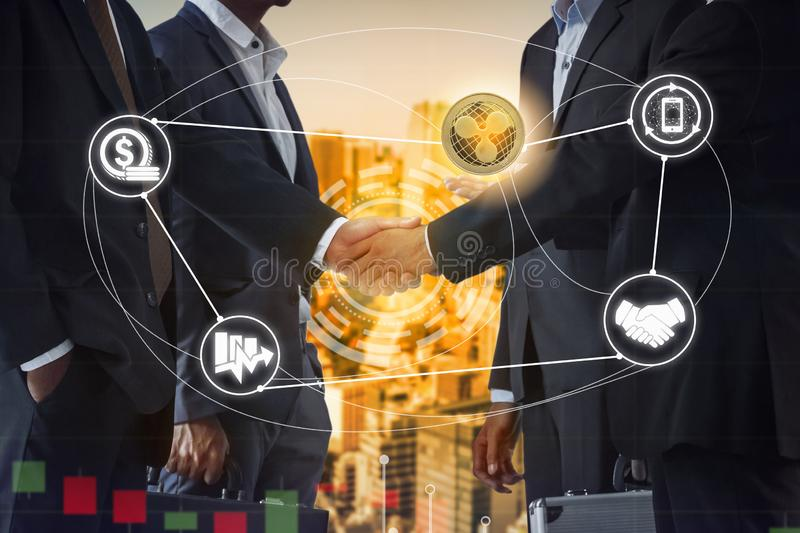 Ripple XRP and Cryptocurrency Payment Accept. Ance concept - Businessman handshaking showing accepted payment by using Ripple coin. Blockchain and financial royalty free stock photos