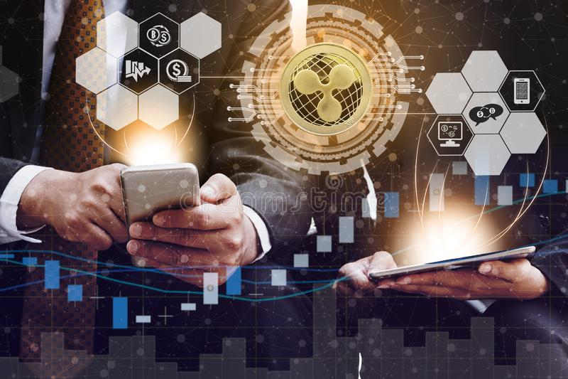 Ripple XRP and Cryptocurrency Trading Concept. Ripple and cryptocurrency investing concept - Businessman using mobile phone application to trade Ripple XRP with stock photos