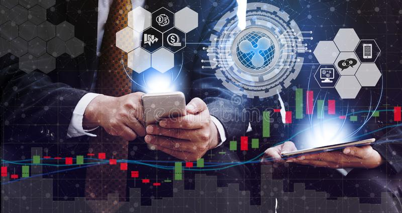 Ripple XRP and Cryptocurrency Trading Concept. Ripple and cryptocurrency investing concept - Businessman using mobile phone application to trade Ripple XRP with stock photo