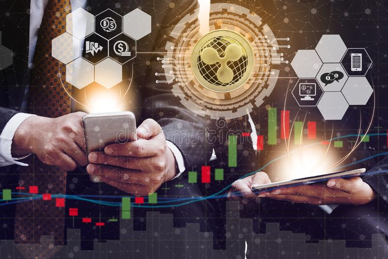 Ripple XRP and Cryptocurrency Trading Concept. Ripple and cryptocurrency investing concept - Businessman using mobile phone application to trade Ripple XRP with royalty free stock photography
