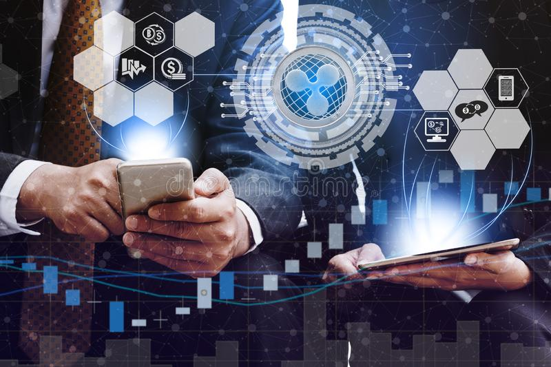 Ripple XRP and Cryptocurrency Trading Concept. Ripple and cryptocurrency investing concept - Businessman using mobile phone application to trade Ripple XRP with stock image