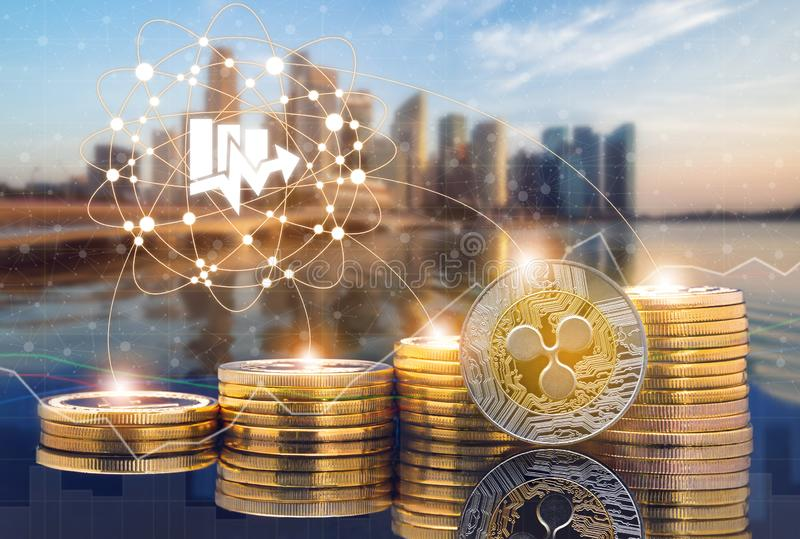Ripple XRP and Cryptocurrency Trading Concept. Ripple XRP and cryptocurrency investing concept - Physical Ripple coins with city background and exchange market stock photography