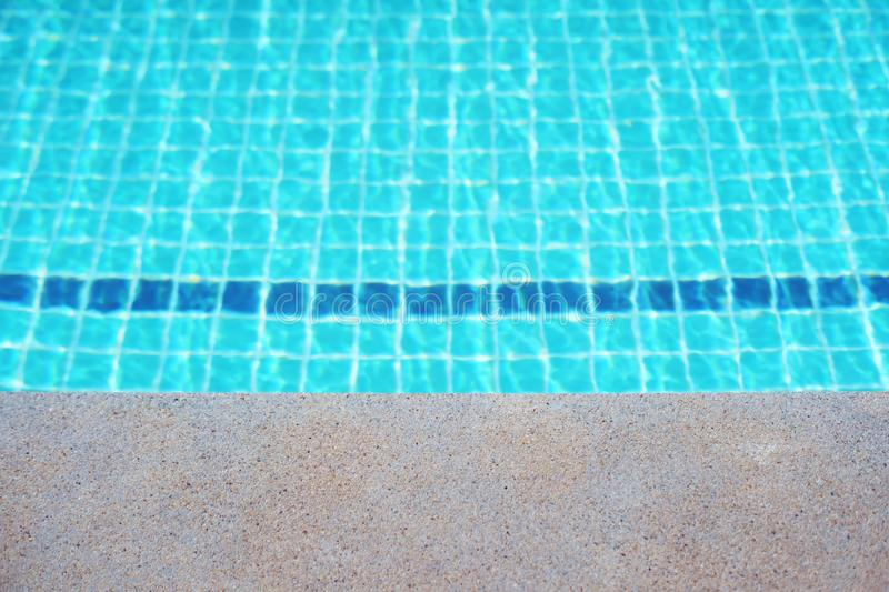 Rippled surface of Swimming pool blue water sun reflecting sleek background royalty free stock images