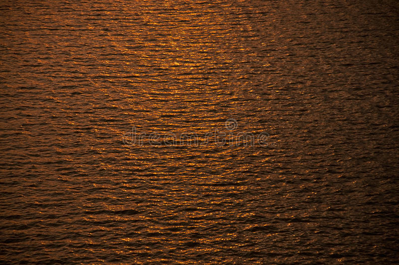 Ripples in gold water. Of dam royalty free stock images