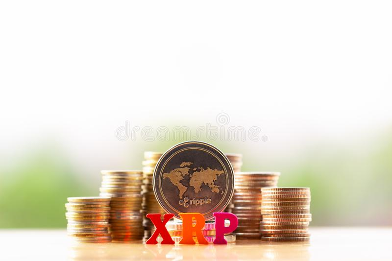 RippleXRP and wooden block XRP on greenery nature background. virtual cryptocurrency mining concept. Cryptocurrency news. BTC. ETH. XRP royalty free stock image